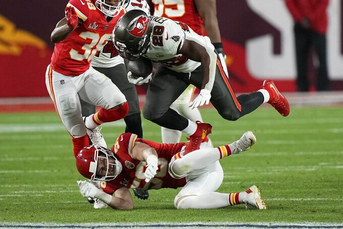 Tampa Bay Buccaneers running back Leonard Fournette (28) falls to the turf against the Kansas City Chiefs during the second half of the NFL Super Bowl 55 football game Sunday, Feb. 7, 2021, in Tampa, Fla. (AP Photo/David J. Phillip)