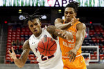 Auburn guard Allen Flanigan, left, and Tennessee guard Yves Pons, right, battle for a rebound during the second half of an NCAA basketball game Saturday, Feb. 27, 2021, in Auburn, Ala. (AP Photo/Butch Dill)