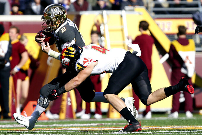 Minnesota quarterback Tanner Morgan (2) runs with the ball against Maryland linebacker Chance Campbell (44) during an NCAA college football game Saturday, Oct. 26, 2019, in Minneapolis. (AP Photo/Stacy Bengs)