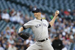 New York Yankees starting pitcher J.A. Happ throws against the Seattle Mariners in the first inning of a baseball game Monday, Aug. 26, 2019, in Seattle. (AP Photo/Elaine Thompson)