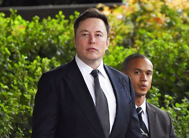 """FILE - In this Wednesday, Dec. 4, 2019 file photo, Tesla CEO Elon Musk arrives at U.S. District Court in Los Angeles. Musk did not defame a British cave explorer when he called him """"pedo guy"""" in an angry tweet, a Los Angeles jury found Friday, Dec. 6, 2019. (AP Photo/Mark J. Terrill, File)"""