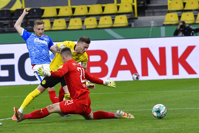 Dortmund's Marco Reus scores his side's third goal during the German Soccer Cup semifinal match between Borussia Dortmund and Holstein Kiel in Dortmund, Germany, Saturday, May 1, 2021. (AP Photo/Martin Meissner, Pool)