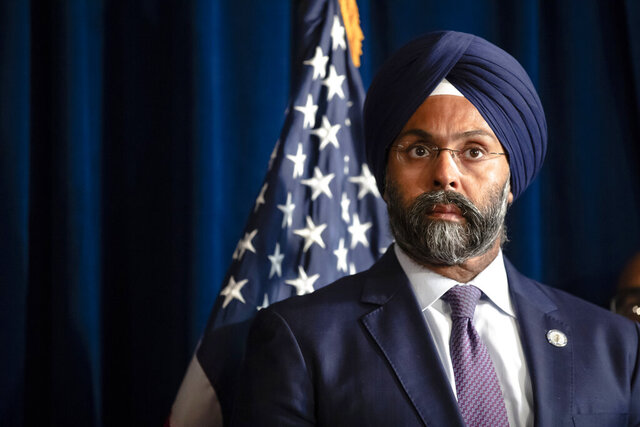 FILE- In this Aug. 5, 2019 file photo, New Jersey Attorney General Gurbir Grewal is shown during a bill signing ceremony at the state capital in Trenton, N.J. The release of New Jersey state troopers' disciplinary reports going back to 2000 won't go forward on Wednesday, July 15, 2020, as the attorney general planned because of a court order blocking their release. (AP Photo/Matt Rourke, File)