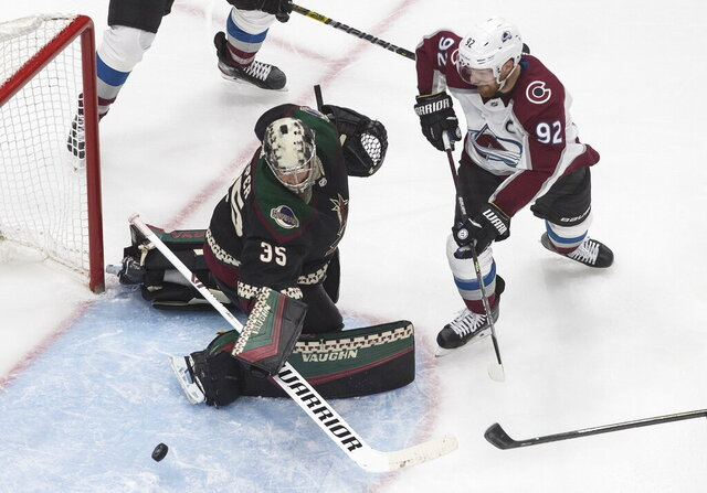 Colorado Avalanche's Gabriel Landeskog (92) is stopped by Arizona Coyotes goalie Darcy Kuemper (35) during the second period of an NHL hockey Stanley Cup first-round playoff series, Saturday, Aug. 15, 2020, in Edmonton, Alberta. (Jason Franson/The Canadian Press via AP)