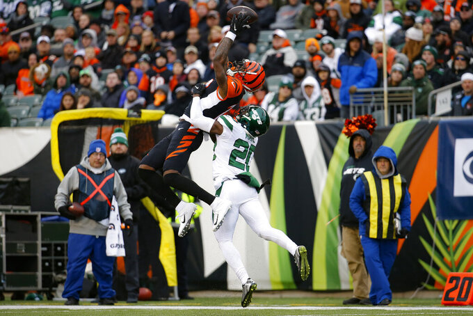 Cincinnati Bengals wide receiver Auden Tate (19) catches a pass against New York Jets free safety Marcus Maye (20) during the first half of an NFL football game, Sunday, Dec. 1, 2019, in Cincinnati. (AP Photo/Frank Victores)