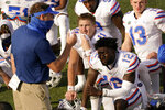 Florida quarterback Kyle Trask (11) listens as head coach Dan Mullen speaks to his players after an NCAA college football game against Vanderbilt Saturday, Nov. 21, 2020, in Nashville, Tenn. Florida won 38-17. (AP Photo/Mark Humphrey)