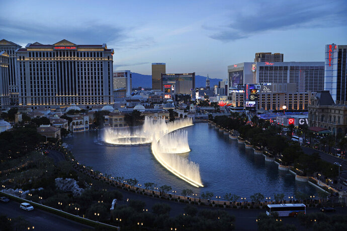 FILE - In this April 4, 2017, file photo, the fountains of Bellagio erupt along the Las Vegas Strip in Las Vegas. The NFL on Tuesday, Jan. 21, 2020, detailed its draft plans for April 23-25 on the city's glittering Strip. The league knows it has a long ways to go to match the previous road shows, particularly in Philadelphia and Nashville. It believes it has found the right place in the Nevada desert. (AP Photo/John Locher, File)