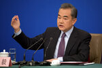 FILE - In this Friday, March 8, 2019, file photo, Chinese Foreign Minister Wang Yi speaks during a press conference on the sidelines of the annual meeting of China's National People's Congress (NPC) in Beijing. Wang said at an annual news conference Friday, China is accelerating efforts to reach an agreement with the 10 countries of the Association of Southeast Asian Nations to avoid conflicts over the South China Sea. (AP Photo/Mark Schiefelbein, File)