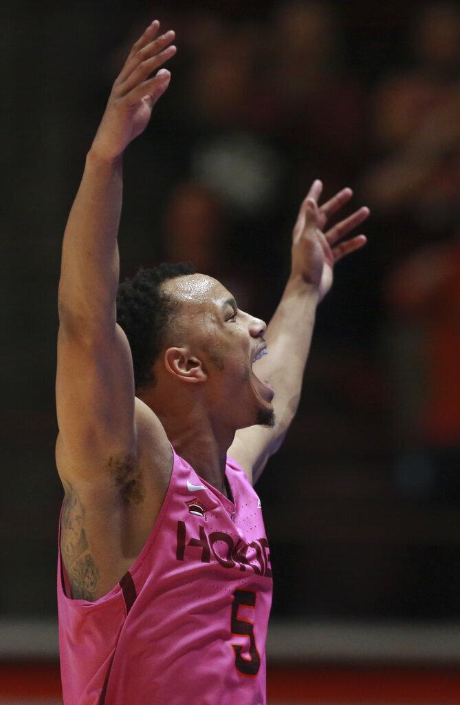 Virginia Tech's Justin Robinson celebrates during the second half against Syracuse in an NCAA college basketball game in Blacksburg, Va., Saturday, Jan. 26, 2019. (Matt Gentry/The Roanoke Times via AP)