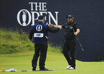 Ireland's Shane Lowry turns to his caddie Bo Martin and celebrates as he wins the British Open Golf Championships on the 18th green at Royal Portrush in Northern Ireland, Sunday, July 21, 2019.(AP Photo/Jon Super)