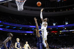 Villanova's Saddiq Bey, right, goes up for a shot against Georgetown's Jagan Mosely during the first half of an NCAA college basketball game, Saturday, Jan. 11, 2020, in Philadelphia. (AP Photo/Matt Slocum)