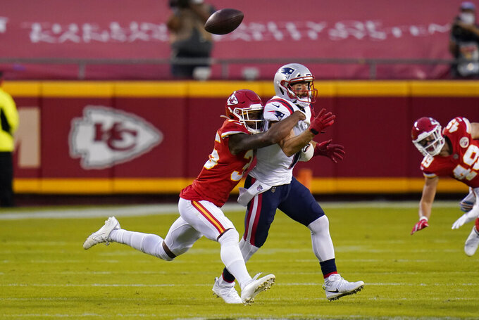 Kansas City Chiefs cornerback Charvarius Ward, left, breaks up a pass intended for New England Patriots wide receiver Julian Edelman during the first half of an NFL football game, Monday, Oct. 5, 2020, in Kansas City. (AP Photo/Jeff Roberson)
