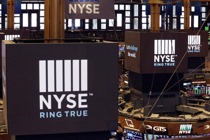 FILE- In this Aug. 21, 2018, file photo screens above trading posts on the floor of the New York Stock Exchange show the NYSE logo.  U.S. stocks rallied in morning trading on Wall Street Tuesday, May 21, after the U.S. government temporarily eased off its proposed restrictions on technology sales to Chinese companies.   (AP Photo/Mark Lennihan, File)(AP Photo/Richard Drew, File)