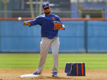 FILE - In this Monday, Feb. 18, 2019 file photo, New York Mets infielder Robinson Cano throws to first during spring training baseball practice in Port St. Lucie, Fla. For years, the NL East has been soft as a bunt single. Not anymore. In addition to defending champion Atlanta, the New York Mets, Philadelphia Phillies and Washington Nationals all have enough firepower to potentially contend for the playoffs. (AP Photo/Jeff Roberson, File)
