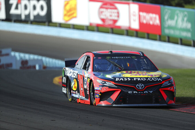 Martin Truex, Jr., competes in a NASCAR Cup Series auto race at Watkins Glen International, Sunday, Aug. 4, 2019, in Watkins Glen, N.Y. (AP Photo/John Munson)