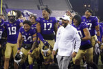 Washington coach Jimmy Lake celebrates with the team after Washington defeated Utah 24-21 in an NCAA college football game Saturday, Nov. 28, 2020, in Seattle. (AP Photo/Ted S. Warren)