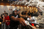 Atlanta Braves relief pitcher Touki Toussaint (62) celebrates in the clubhouse after defeating the San Francisco Giants in a baseball game to clinch the NL East baseball title Friday, Sept. 20, 2019, in Atlanta. (AP Photo/John Bazemore)