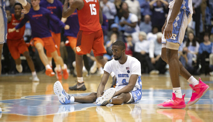 North Carolina's Brandon Robinson (4) reacts after missing a three-point shot at the buzzer in an NCAA college basketball game against Clemson on Saturday, Jan. 11, 2020, at the Smith Center in Chapel Hill, N.C. (Robert Willett/The News & Observer via AP)