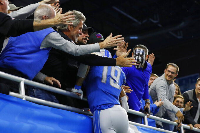 Detroit Lions wide receiver Kenny Golladay jumps into the stands after catching a 41-yard pass for a touchdown during the second half of an NFL football game against the New York Giants, Sunday, Oct. 27, 2019, in Detroit. (AP Photo/Paul Sancya)