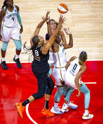Las Vegas Aces center Liz Cambage (8) shoots to score over New York Liberty forward Reshanda Gray and others during the first quarter of a WNBA basketball game Thursday, June 17, 2021, in Las Vegas. (L.E. Baskow/Las Vegas Review-Journal via AP)