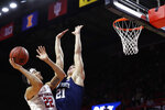 Rutgers guard Caleb McConnell (22) shoots over Penn State forward John Harrar (21) during the first half of an NCAA college basketball game Tuesday, Jan. 7, 2020, in Piscataway, N.J. (AP Photo/Michael Owens)