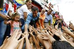 Venezuela's opposition leader and self-proclaimed interim president Juan Guaido greets supporters during a visit to Socopo in Barinas state, Venezuela, Saturday, June 1, 2019. Guaido is taking his campaign to oust President Nicolas Maduro to the birthplace of Hugo Chavez, the socialist leaders' mentor. (AP Photo/Ariana Cubillos)