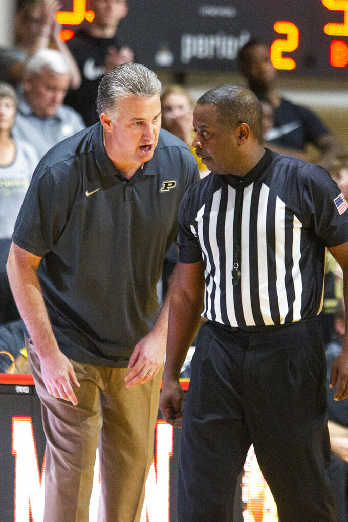 Purdue head coach Matt Painter talks with a referee during the second half of the team's NCAA college basketball game against Virginia Commonwealth at the Emerald Coast Classic in Niceville, Fla., early Saturday, Nov. 30, 2019. Purdue won 59-56. (AP Photo/Mark Wallheiser)