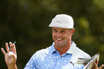 Bryson DeChambeau jokes with the gallery on the third tee during the final round of play in the Tour Championship golf tournament at East Lake Golf Club, Sunday, Sept. 5, 2021, in Atlanta. (AP Photo/Brynn Anderson)