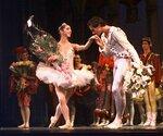 FILE - This Jan. 27, 1998 file photo shows Oscar Torrado kissing ballerina Lorna Feijoo on the hand during a curtain call following Ballet Nacional de Cuba's performance of