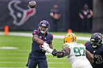 Houston Texans quarterback Deshaun Watson throws over Green Bay Packers defensive tackle Kenny Clark (97) during the second half of an NFL football game Sunday, Oct. 25, 2020, in Houston. (AP Photo/Sam Craft)