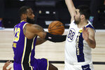 Los Angeles Lakers forward LeBron James (23) drives to the basket against Indiana Pacers center Goga Bitadze (88) during the second quarter of an NBA basketball game Saturday, Aug. 8, 2020, in Lake Buena Vista, Fla. (Kim Klement/Pool Photo via AP)