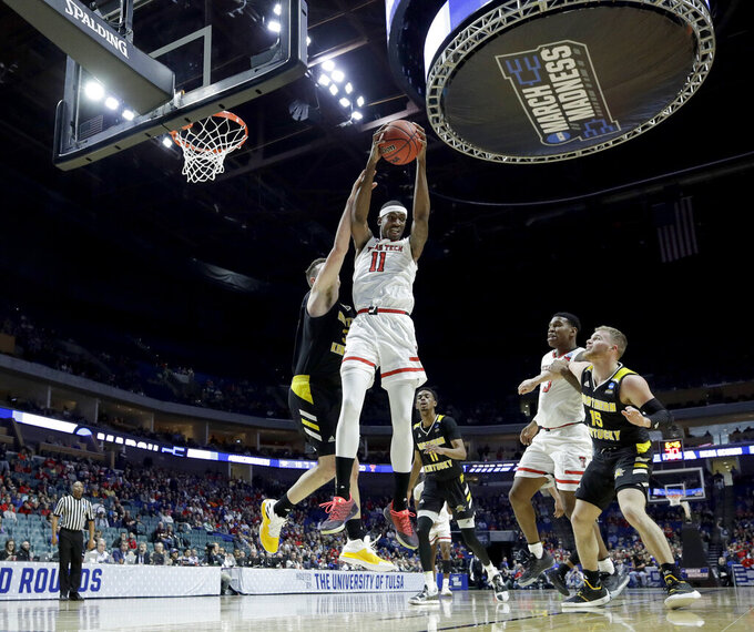 Texas Tech's Tariq Owens (11) beats Northern Kentucky's Drew McDonald to a rebound during the first half of a first round men's college basketball game in the NCAA Tournament Friday, March 22, 2019, in Tulsa, Okla. (AP Photo/Charlie Riedel)
