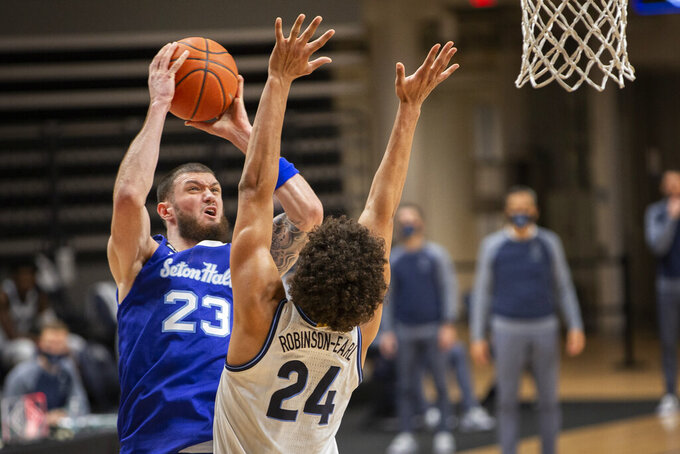 Seton Hall forward Sandro Mamukelashvili (23) shoots over Villanova forward Jeremiah Robinson-Earl (24) during the second half of an NCAA college basketball game Tuesday, Jan. 19, 2021, in Villanova, Pa. Villanova won 76-74. (AP Photo/Laurence Kesterson)