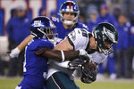 Philadelphia Eagles tight end Dallas Goedert (88) is stopped after a catch by New York Giants defensive back Michael Thomas (31) NFL football game, Sunday, Dec. 29, 2019, in East Rutherford, N.J. (AP Photo/Seth Wenig)