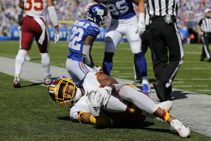 Washington Redskins cornerback Josh Norman reacts after being hurt on a play during the first half of an NFL football game against the New York Giants, Sunday, Sept. 29, 2019, in East Rutherford, N.J. (AP Photo/Adam Hunger)