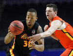 Cameron Jackson of Wofford, left, battles for a loose ball against Drew McDonald of Nofrthern Kentucky during the College All-Star game at the Final Four NCAA college basketball tournament, Friday, April 5, 2019, in Minneapolis. (AP Photo/David J. Phillip)