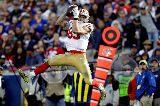 FILE - In this Dec. 30, 2018, file photo, San Francisco 49ers tight end George Kittle catches a pass against the Los Angeles Rams during the first half in an NFL football game in Los Angeles. No tight end has ever been as prolific with the ball in his hands as Kittle was for the 49ers last season when he used his speed and ability to run after the catch to record the most yards receiving ever in a season for a tight end. (AP Photo/Marcio Jose Sanchez, File)