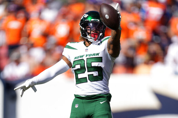 New York Jets running back Ty Johnson (25) signals first down against the Denver Broncos during the first half of an NFL football game, Sunday, Sept. 26, 2021, in Denver. (AP Photo/David Zalubowski)