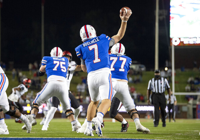 SMU quarterback Shane Buechele (7) throws a pass against Cincinnati during the first half of an NCAA college football game Saturday, Oct. 24, 2020, in Dallas. (AP Photo/Jeffrey McWhorter)