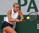 Slovakia's Anna Karolina Schmiedlova plays a shot against Victoria Azarenka of Belarus in the second round match of the French Open tennis tournament at the Roland Garros stadium in Paris, France, Wednesday, Sept. 30, 2020. (AP Photo/Michel Euler)