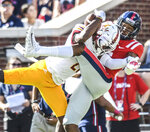 Louisiana Monroe cornerback Corey Straughter (21) breaks up a pass to Mississippi wide receiver DaMarkus Lodge (5) a during an NCAA college football game, Saturday, Oct. 6, 2018, at Vaught-Hemingway Stadium in Oxford, Miss. (Bruce Newman/The Oxford Eagle via AP)