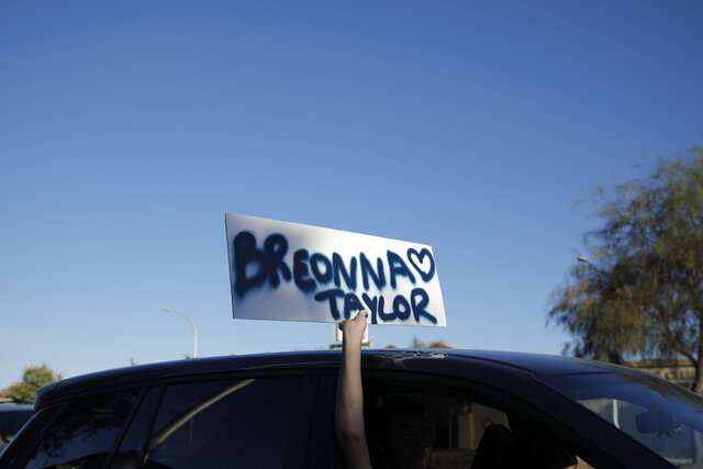 A person holds up a sign with the name of Breonna Taylor during a demonstration in Las Vegas on Friday, June 19, 2020, to mark Juneteenth, the holiday celebrating the day in 1865 that enslaved Black people in Galveston, Texas, learned they had been freed from bondage, more than two years after the Emancipation Proclamation. (AP Photo/John Locher)