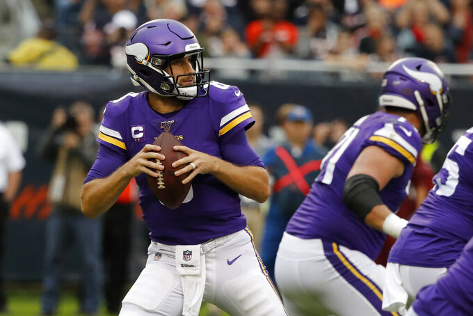 Minnesota Vikings quarterback Kirk Cousins drops back to pass during the first half of an NFL football game against the Chicago Bears Sunday, Sept. 29, 2019, in Chicago. (AP Photo/Charles Rex Arbogast)
