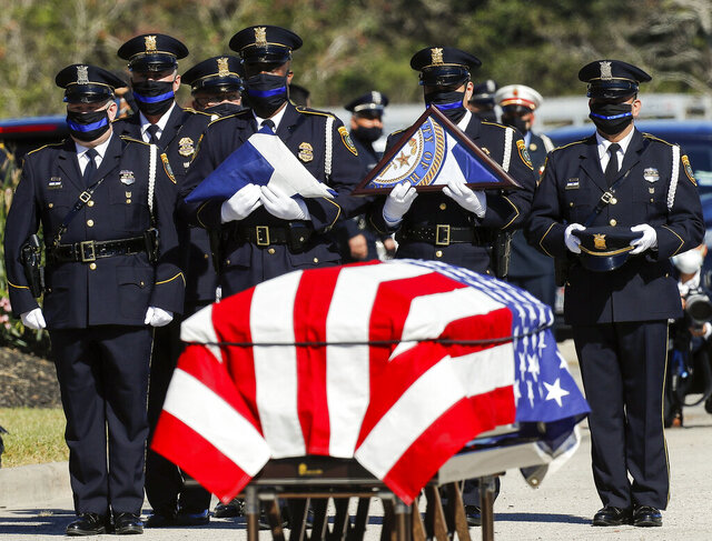 Members of the Houston Police Honor Guard await to present honors to Sgt. Sean Rios' family, during the memorial service at Grace Church Houston on Wednesday, Nov. 18, 2020, in Houston. Rios was fatally shot on Nov. 9 while on his way to work. (Godofredo A. Vásquez/Houston Chronicle via AP)
