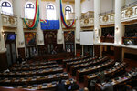 Congress sits partially empty, after lawmakers from the MAS political party, that of former President Evo Morales, did not arrive for session as a form of protest in La Paz, Bolivia, Tuesday, Nov. 12, 2019. Morales, who transformed Bolivia as its first indigenous president, flew to exile in Mexico on Tuesday after weeks of violent protests, leaving behind a confused power vacuum in the Andean nation. Morales backers still have a majority in the body. (AP Photo/Juan Karita)