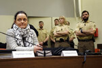 FILE-In this Feb. 7, 2017 taken photo terror suspect Beate Zschaepe sits in the court room waiting for her lawyers in Munich, Germany. Germany's top court has rejected appeals by three defendants over their convictions in one of the country's most high-profile far-right murder trials. The decision announced Thursday by the Federal Court of Justice confirms the life sentence given three years ago to Beate Zschaepe, the only known survivor of the National Socialist Underground group. (AP Photo/Matthias Schrader)