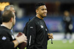 FILE - In this Feb. 27, 2020, file photo, Alabama quarterback Tua Tagovailoa watches a drill at the NFL football scouting combine in Indianapolis. In 54 years of drafting, the Miami Dolphins have taken four quarterbacks in the first round, and two are in the Pro Football Hall of Fame. (AP Photo/Charlie Neibergall, File)