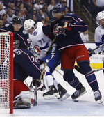 Columbus Blue Jackets' Sergei Bobrovsky, left, of Russia, makes a save as teammate Seth Jones, right, and Tampa Bay Lightning's Anthony Cirelli fight for position in front of the net during the first period of Game 4 of an NHL hockey first-round playoff series, Tuesday, April 16, 2019, in Columbus, Ohio. (AP Photo/Jay LaPrete)