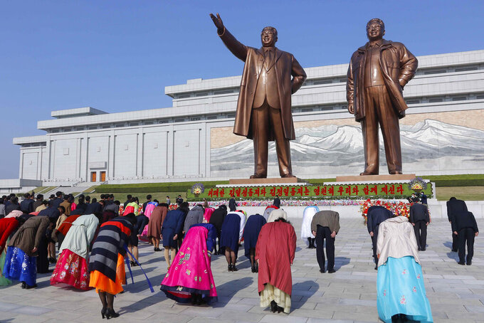 People visit the statues of their late leaders Kim Il Sung and Kim Jong Il on the occasion of the Day of the Sun, the birth anniversary of Kim Il Sung, in Pyongyang, North Korea Thursday, April 15, 2021. (AP Photo/Cha Song Ho)