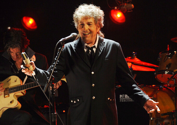 """FILE - In this Jan. 12, 2012, file photo, Bob Dylan performs in Los Angeles. Universal Music Publishing Group is buying legendary singer Bob Dylan's entire catalog of songs. The company said Monday, Dec. 7, 2020, that the deal covers 600 song copyrights including """"Blowin' In The Wind,"""" """"The Times They Are a-Changin',"""" and """"Knockin' On Heaven's Door,"""" """"Tangled Up In Blue."""" (AP Photo/Chris Pizzello, File)"""
